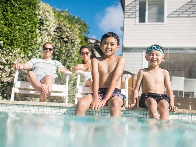 Family enjoy clean water pool